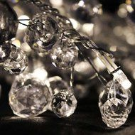 CHAIN BATTERY CRYSTAL CHIC Clear crystal look beads intertwined with 25 LED pin lights.  Length -  2.7m of which 1.6m is illuminated  Power source - 3 x AA batteries (not included)  Currently IN STOCK