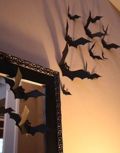 So simple it's scary! Using black cardstock paper, add texture to your walls with 3D bats. Cut out a variety of different-sized creatures and scatter them around your walls using tape. Source: Thrifty Decor Chick