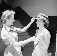 THE BRITISH ARMY IN NORTH AFRICA 1943    A new ATS girl tries on her cap for the first time before leaving Cairo for Palestine where she will receive preliminary training, 31 May 1943.