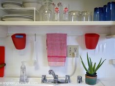small kitchen ideas tension rod above the sinks and open shelving, kitchen design, organizing, shelving ideas, urban living Small Kitchen Organization, Small Kitchen Storage, Home Organization, Storage Spaces, Kitchen Small, Extra Storage, Small Storage, Pantry Organisation, Household Organization