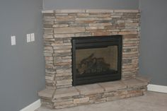 corner fireplace, stop stone just below this, wood mantle on top- open to corner