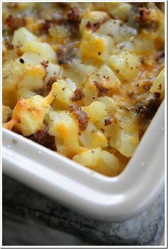 Cheesy Potato Breakfast Casserole 1 # Italian Sausage, cooked 1 onion, sauteed in sausage drippings 7 eggs 1/2 c milk 20 oz bag hash brown 8 oz cheddar cheese Salt & Pepper Preheat oven to 350. Spray 9 x 13 casserole dish with non-stick spray. In a large mixing bowl, combine all ingredients, including sausage and onions. Pour into prepared casserole dish. Reserve one cup cheese for topping. Bake for 35 minutes. Top with reserved cheese. Bake 8 min. Allow to rest for 15-20 minutes.