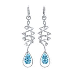 COLORED STONE JEWELRY    Under $2,500    Diamond, 18k gold, and blue topaz interchangeable drop earrings; $2,495; Hidalgo,