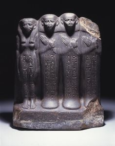pennmuseum: Statue group of a family with a father and mother on the left and their two sons beside them. The son, Pepi is identified as the donor of this statue. The physiognomy of the group reflects royal figures of the 12th/13th dyns. with large ears, heavy lidded eyes.