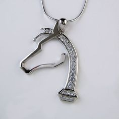 Sterling Silver and Vermeil Horseshoe Nail Horse Head Pendant Necklace with CZ is a creative use of the Horseshoe Nail design. With four options of color, the mane and base of neck is comprised of the