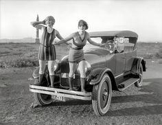 This photograph was taken in 1923 in the Bay Area. Being California, there are, of course, two lovely damsels and the star of our show, a Peerless Touring car with a stunning two-color paint job. The 3 Ps - Peerless, Piece-Arrow, and Packard - were considered to be the epitome of American luxury automobiles, and each marque was famous for the quality of its materials and the craftsmanship lavished on its products.
