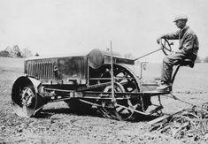 3-wheel John Deere tractor