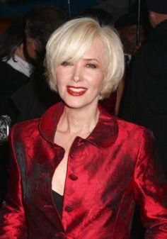 Janine Turner in a short bob hair style parted on the side with long, wispy bangs.