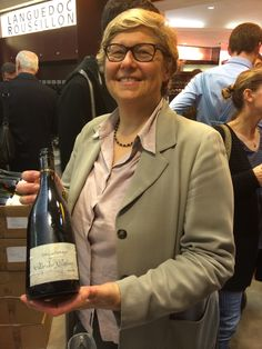 """Sparkling Catherine, from Champagne Philipponnat proudly holding a bottle of """"Clos des Goisses 2005"""""""