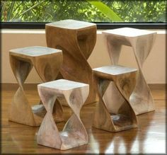It is beautiful set of modern stools. These stools are made of wood but finishing work has made it look like these are made of marble. The light colors like marble colors have good color combination with the floor and walls.