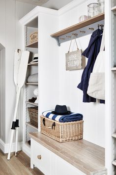 Cottage mudroom features a built-in bench with wood top placed under a gray coat hook lining a shiplap backsplash flanked by tall open shelves. Home Upgrades, Farmhouse Side Table, Decor, Mudroom, Home, Cheap Home Decor, Interior, Cute Dorm Rooms, Home Decor