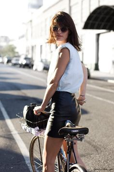 Hanneli Mustaparta, white shirt, black leather skirt, sunglasses, bike / Garance Doré