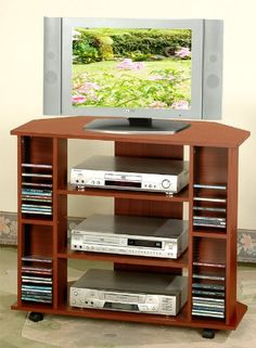 Corner TV Stand with Cd Rack and Casters in Cherry Finish...