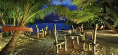 Rustic beach setting for chilled food and drinks at Sainte Anne Resort & Spa, Seychelles