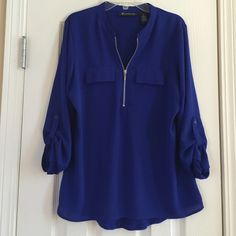 INC size S Blue 3/4 sleeve top INC size small 3/4 sleeve top.  There is a silver zipper on the front and faux pockets on each side.  The top is blue and also has buttons on the sleeves for a super cute accent. INC International Concepts Tops Tees - Long Sleeve