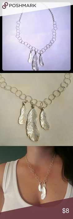 "Charming charlie Silver feather necklace PLEASE ASK QUESTIONS BEFORE BUYING OR OFFERING   PLEASE NOTE THIS IS NOT REAL SILVER THEREFORE THERE WILL BE SOME TARNISH AS WE ALL KNOW THAT'S WHAT HAPPENS WITH ITEMS THAT ARE NOT REAL     Charming charlie Super super cute silver tone feather necklace    12"" long  3"" extender Charming Charlie Jewelry Necklaces"