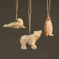 """The natural, artisan-carved ornament is a perfect take on the adored animals of the poles. Hang it on door knobs, walls, or anywhere for a great décor. - Dimensions: 1""""W x 1.5""""L x 2.75""""H - Color: Natu"""