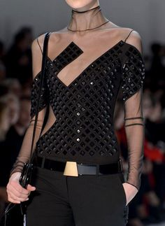 SHE LOVES FASHION...I like this idea of leather & chiffon. Imagine this top in cream with pearls & a full circle skirt. That hard edge with a soft touch.