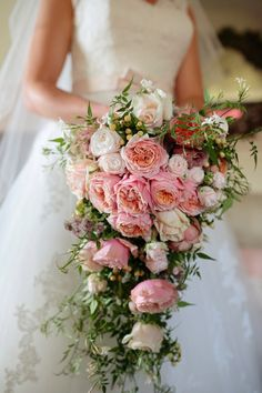 Order flowers that you want to place in your bouquet. Your bridal bouquet is going to be the very first key accessory to. If you would rather have a more compact bouquet, it is generally fine to ha… Cascading Wedding Bouquets, Cascade Bouquet, Bridal Flowers, Cascading Flowers, Bridesmaid Bouquets, Bouquet Bride, Rose Bouquet, Flower Bouquets, Bouquet Wedding