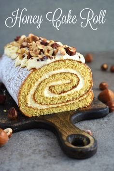 The BEST fluffy and moist Honey Cake Roll that is easier than any cake, filled with scrumptious sweetened condensed milk frosting and topped with hazelnuts for a hint of nutty flavor. This dessert is a family staple and such a crowd-pleaser! Sour Cream Frosting, Sour Cream Cake, Cake Roll Recipes, Dessert Recipes, Cupcakes, Cupcake Cakes, Swiss Roll Cakes, Honey Dessert, Honey Cake