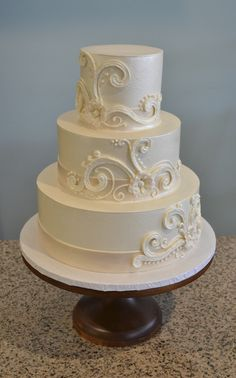 Buttercream wedding cake with whimsical swirls