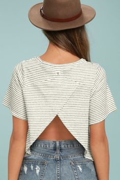 The Billabong Wound Up Black and White Striped Crop Top is so adorable, you'll never want to take it off! Lightweight, textured knit, in a black and white striped pattern, shapes a rounded neckline and short sleeves. A surplice accent creates an open back before ending in a cute, cropped hem. Logo tag at back.