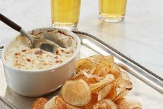 This hot seafood dip, served with potato chips, is an ode to the salt spray of the New England coast. Low Carb Recipes, Snack Recipes, Snacks, Clam Dip, Cream Cheese Potatoes, Seafood Dip, Potato Chips, Clams, Sour Cream