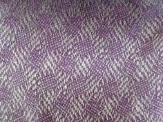 Detail of a cot blanket - pattern from Oelsner 'Handbook of weaves'. Woven in banana yarn