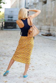 color combo works . . . yellow skirt w/ black polka dots, black racer back top, turquoise flats