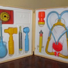 Fisher Price Dr. Kit- hit Jon over the head with this... time for real doctors to intervene!!!! (He had to have stitches, and dad made me tell Dr. what happened!)