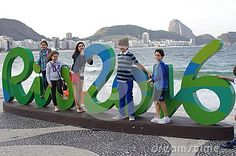 Rio2016 Olympic logo on Copacabana beach with children posing for pictures. Photo taken on Aug 5th, 2016.