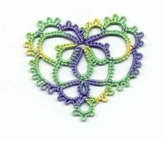 Tatted heart R=ring, - =picot, ch=chain, j=shuttle join, J=regular join  Center Clover: R 6-4-4-6, R6J6-6-6,R 6J4-4-6  ch 6-6-6-6, j middle picot first ring, ch 6-6,  j middle picot 2nd ring, ch 4-4, j to same picot, chain 6-6,  j to middle picot of last ring, chain 6-6-6-6 join to base of clover.  2nd round (can be done without cutting thread if you leave some space to tie into at the end):  ch2-2-2-2 j 2-2-2-2 j 2-2-2-2 j 2-2-2-2-2-2-2 j 2-2-2-2,j to bottom picot,  chain 2J2-2-2-2-2,j to…
