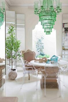 really amazing green chandelier and pretty light-filled room