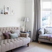 Country living room with button linen sofa