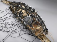 TRAPPED Detail: Caged woven vessel with woven,stitched,carved objects enclosed. Artist: Shannon Weber, Oregon