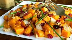 Roasted Butternut Squash Salad - To balance indulgent eats with healthier choices, add this big salad for supper featuring roasted vegetables, cranberries and toasted walnuts topped with a zingy maple-dijon vinaigrette to your repertoire. Butternut squash is the seasonal darling that takes eaters from autumn through the winter in a variety of tasty ways, whether baked and stuffed or as the basis for succulent soups and stews.