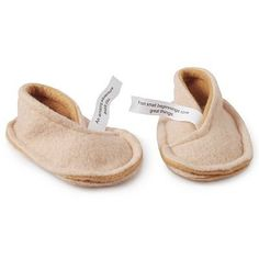 "Baby Fortune Cookie Booties . $28.00. Give your tot a cushy step forward in the right direction with these charming, fortune cookie slippers. Handmade from extra-plush fleece with floor-gripping soles, each slipper curls into a delectable cookie shape when not in use. Comes with two thoughtful fortunes for your baby to grow into: the ultimate treat for your little sweet.Fortunes read: ""From small beginnings come great things"" on one bootie and ""An amazing adventure await..."