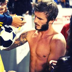 David Beckham took off his shirt after a game for the LA Galaxy. So the Topless David Beckham showed off his Tattoos and signed autographs for fans! See the Video on our YouTube Channel in the link © Atlantic Images