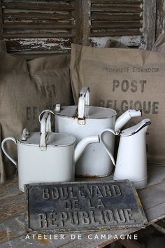 Antique White Enamelware watering cans/pitcher