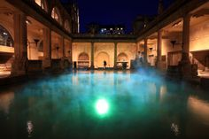 A man looks as projected coloured lights illuminate steam rising from the Great Bath of the Roman Baths as part of the Illuminate Bath 2012 festival on January 26, 2012 in Bath, England. The light installation called Frequency, created for the Roman Baths by Bath Spa University graduates Alexander Cotterell, Will Kendrick, Tom Newell and Ollie Davies, is one of the highlights of the Illuminate Bath festival.  Illuminate Bath 2012, organised by the Bath Spa University and RELAYS , a London…