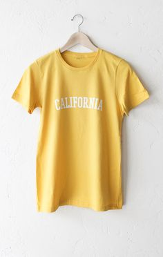 - Description Details: Super soft, relaxed fit organic women's short sleeve t-shirt in yellow with print featuring 'California'. Women's Fit/Relaxed. Brand: NYCT Clothing. Measurements: (Size Guide) S