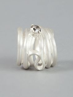 Silver-tone brass ring from Maison Martin Margiela featuring a coiled band and a cut glass stone set at the front.