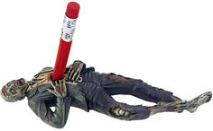 Somebody needs to get this for me for Christmas.... Impaled Zombie Pencil Holder