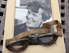 Goggles worn by Amelia Earhart and photographs of the famed aviator pulled in more than $31,000 at an auction in Oakland, California.    A spokesman for Clars Auction Gallery says the winning bid for the set of 1920s Luxor aviator goggles with a cracked left lens was $17,775.    The goggles previously were owned by Barbara Englehardt, a Contra Costa County resident who got them from a friend about 20 years ago.