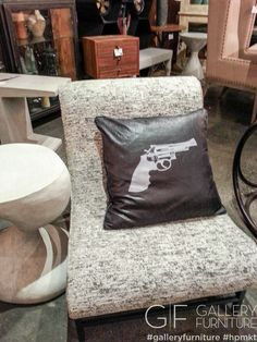 Here we shot this interesting revolver printed pillow on an armless chair! It would work beautifully in a man cave. We are noticing all the patterns and prints that are being used @High Point Market! #HPMKT #GFHPMKT #2013 #trends #home_fashion | Houston TX | Gallery Furniture |