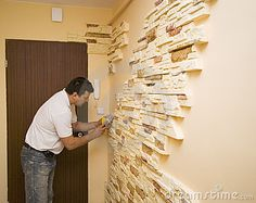 A worker putting new decorative tiles on the walls.   <a href='http://www.dreamstime.com/interiors-rcollection5192-resi208938' STYLE='font-size:13px; text-decoration: blink; color:#FF0000'><b>HOME BUILDING & RENOVATION »</b></a>