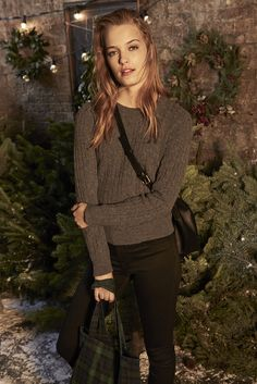 Leggings and a knitted jumper - fetching clothes for the festive season.