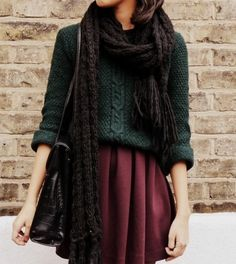 Black knit scarf, black leather purse, hunter green chunky sweater, full short maroon skirt