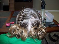When Cina did my hair for the parade, this is an idea of what it looked like. It was a pretty crazy hair style!
