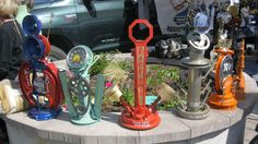 A line up of trophies made from recycled car parts